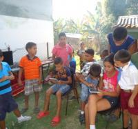 Joven Club en actividad comunitaria de Villa Blanca