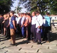 Trabajadores del Joven club de computación de Masó participan  en acto municipal  por el Día del Comunicado.