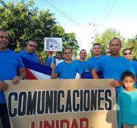 Trabajadores de Yara presente en el desfile por 1ro de mayo.