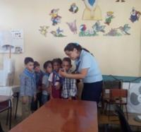 Trabajadores del Joven Club Campechuela 1 intercambian con alumnos de la Escuela Especial Fructuoso Rodríguez.